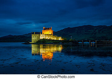 Illuminated Eilean Donan Castle at night, Scotland
