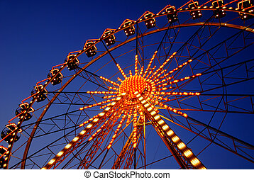 Illuminated ferris wheel - Illuminated red ferris wheel on...
