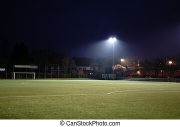Illuminated football field in the night