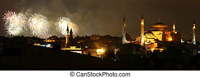 Illuminated Hagia Sophia and fireworks (national holiday) in Istanbul at night