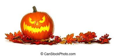 Illuminated Halloween Jack o Lantern with border of red autumn leaves isolated on white