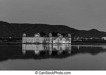 Illuminated Jal Mahal palace at night in Jaipur