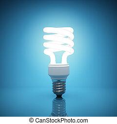 Illuminated light bulb on blue background