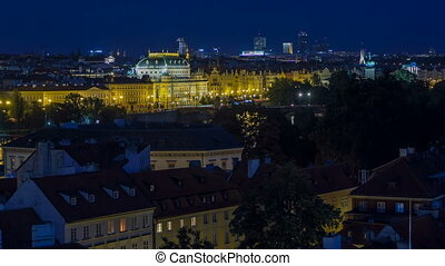 Illuminated National Theatre in Prague at night with...