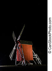 Illuminated old traditional windmill in Sweden