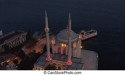 Illuminated Ortakoy Mosque from Above at Dusk, Aerial Birds Eye View perspective