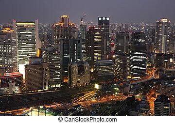 Illuminated Osaka City in Japan at night from high above