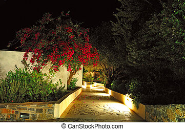 Illuminated path at luxury hotel, Crete, Greece
