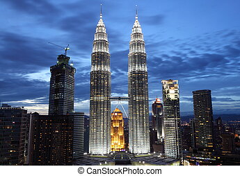 Illuminated Petronas Towers Kuala Lumpur at twilight