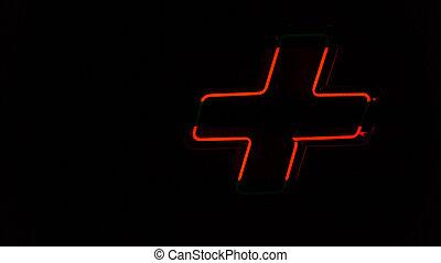 Illuminated red neon light, plus symbol on the wall - ...
