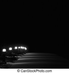 Illuminated Snowy Park Footpath Lights, Bright Lit White Outdoor Pathway Pavement Lanterns Lampposts Row Perspective At Night, First Winter Snow on Evergreen Shrubs, Brightly Glowing Walk Lamps, Loneliness Concept Solitude Metaphor, Vertical Deserted Night Scene Closeup, Black Isolated Copy Space Background