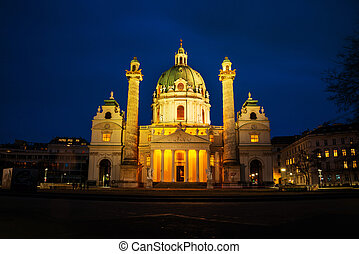 Illuminated St Charles Church at night, Vienna, Austria