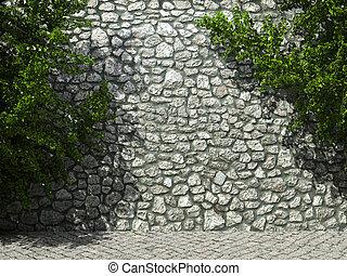 illuminated stone wall and ivy
