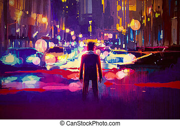 illuminated street at night - man standing on illuminated...