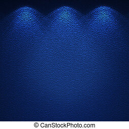 Illuminated texture of the blue wall