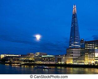 Illuminated The Shard skyscraper at night in London, England
