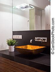 Illuminated washbasin in modern toilet - Close-up of...