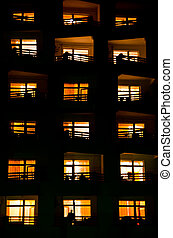illuminated windows of a house at night