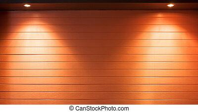 Illuminating pot-lights shining down on a wooden wall