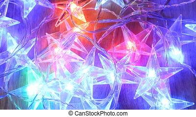 Illumination garland stars decoration blinking background.