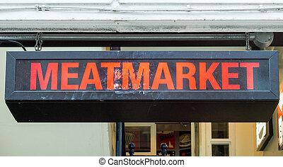 Meatmarket Sign - Illumintated Meatmarket Sign Above Doorway