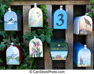 Eight mailboxes hand-painted with natural scenes