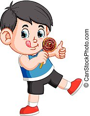A boy licking lollipop and giving you thumb up