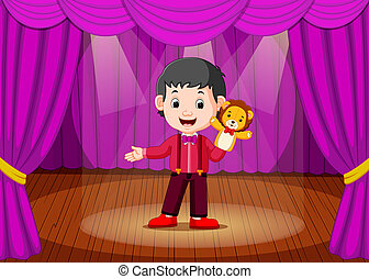a boy playing puppet in the stage