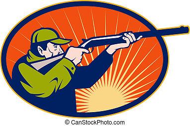 Hunter aiming rifle shotgun side view set inside an ellipse...