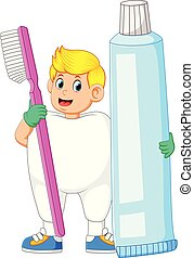 A man wearing tooth costume and holding big toothbrush and big toothpasta