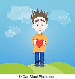Boy with heart in his hands outdoor