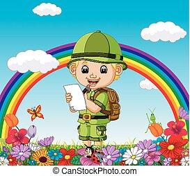 Cartoon boy writing in a flower garden with rainbow