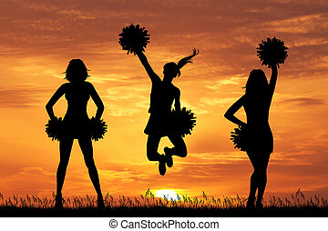cheerleader silhouette at sunset