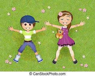 children lying on the grass