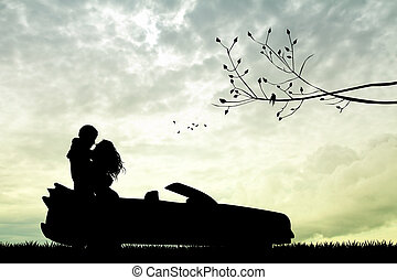 couple kissing on car at sunset