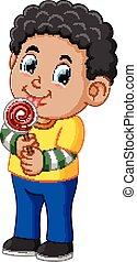 Curly boy licking a lollipop