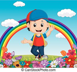 Cute boy in a flower garden with rainbow