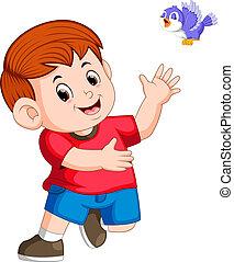 cute boy play with a bird