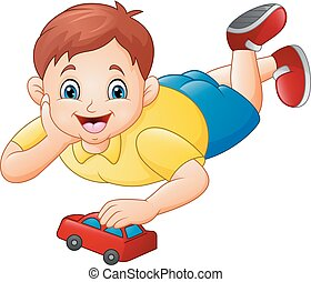 Cute little boy playing red toy car