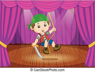 cute little boy wearing pirate costume on stage