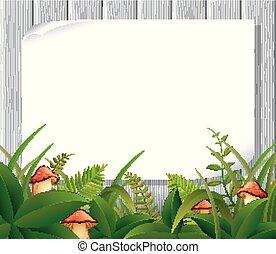 Empty paper blank on wooden signboard in the garden