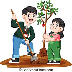 Father and daughter planting tree in the park