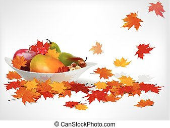 fruits and autumn leaves on a plate