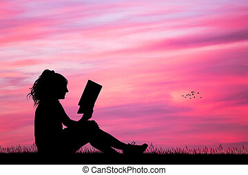 girl reading a book at sunset