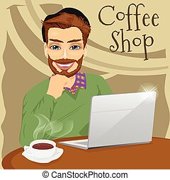 handsome hipster man with laptop enjoying a hot coffee in coffee shop