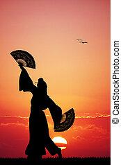 Japanese dance at sunset - illustration of Japanese dance at...