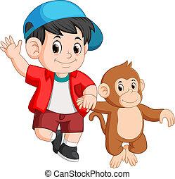 little boy is walking with a monkey