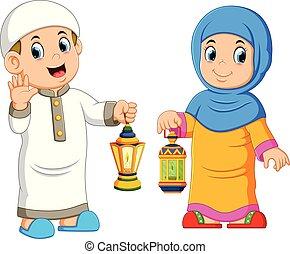Moslem couple holding lantern