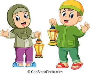 Moslem kids holding lantern