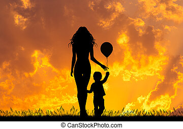 mother and child with balloon at sunset